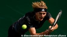 Alexander Zverev, of Germany, returns a shot to Lloyd Harris, of South Africa, during the quarterfinals of the US Open tennis championships, Wednesday, Sept. 8, 2021, in New York. (AP Photo/Elise Amendola)