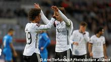 Germany's Leroy Sane, left, celebrates with Leon Goretzka after scoring his side's third goal during the World Cup 2022 group J qualifying soccer match between Iceland and Germany in Reykjavik, Iceland, Wednesday Sept. 8. 2021. (AP Photo/Arni Torfason)
