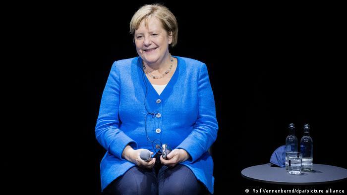 German Chancellor Angela Merkel smiles at a podium discussion with Nigerian writer Chimamanda Ngozi Adichie
