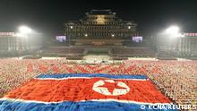 A giant North Korean flag is unhurled during a paramilitary parade held to mark the 73rd founding anniversary of the republic at Kim Il Sung square in Pyongyang in this undated image supplied by North Korea's Korean Central News Agency on September 9, 2021. KCNA via REUTERS ATTENTION EDITORS - THIS IMAGE WAS PROVIDED BY A THIRD PARTY. REUTERS IS UNABLE TO INDEPENDENTLY VERIFY THIS IMAGE. NO THIRD PARTY SALES. SOUTH KOREA OUT. NO COMMERCIAL OR EDITORIAL SALES IN SOUTH KOREA.