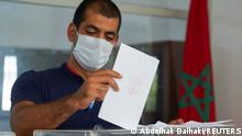 A man casts his vote at a polling station during parliamentary and local elections, in Casablanca, Morocco September 8, 2021. REUTERS/Abdelhak Balhaki