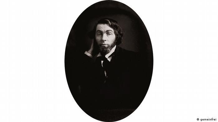 Schwarz-weiß Fotografie von Walt Whitman im Anzug als junger Mann