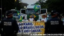 Police officers stands next to a blockade to bar Access to the Brazil's Supreme Court headquarters for the truck drivers and supporters of the Brazil's President Jair Bolsonaro during a protest in Brasilia, Brazil, September 8, 2021. REUTERS/Adriano Machado