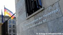 A flag flutters in front of the German finance ministy in Berlin, Germany, September 9, 2021, as German prosecutors raided the finance and justice ministries as part of an investigation into possible obstruction of justice by the government?s anti-money laundering agency. REUTERS/Annegret Hilse