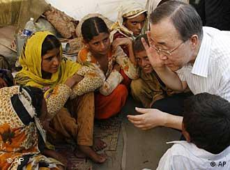 In this photo provided by the United Nations, U.N. Secretary General Ban Ki-moon visits the Sultan Colony, an Internally Displaced Persons' camp, in the Province of Punjab, near the city of Multan. Sunday, Aug. 15, 2010. Ban said Sunday he has never seen anything like the flood disaster in Pakistan after surveying the devastation and urged foreign donors to speed up assistance to the 20 million people affected. (AP Photo/United Nations, Evan Shneider)