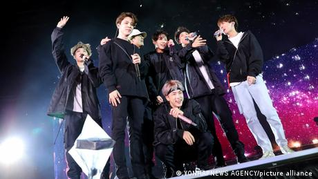 BTS, several young people dressed mainly in black on stage, with microphones