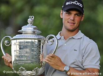 Martin Kaymer poses with a trophy