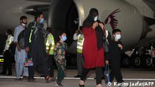 Evacuees from Afghanistan arrive at Hamad International Airport in Qatar's capital Doha on the first flight carrying foreigners out of the Afghan capital since the conclusion of the US withdrawal last month, September 9, 2021. (Photo by KARIM JAAFAR / AFP)