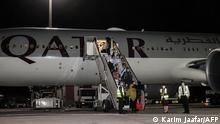 Evacuees from Afghanistan, including US citizens, arrive at Hamad International Airport in Qatar's capital Doha on the first flight carrying foreigners out of the Afghan capital since the conclusion of the US withdrawal last month, September 9, 2021. (Photo by KARIM JAAFAR / AFP)