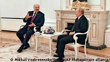 Russian President Vladimir Putin, right, and Belarusian President Alexander Lukashenko talk during their meeting in Moscow, Russia, Thursday, Sept. 9, 2021. (Mikhail Voskresensky, Sputnik, Kremlin Pool Photo via AP)