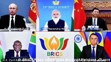 This handout photograph provided by the Press Information Bureau shows leaders of the BRICS nations, clockwise from top left, Russian President Vladimir Putin, Indian Prime Minister Narendra Modi, Chinese President Xi Jinping, South African President Cyril Ramaphosa and Brazilian President Jair Bolsonaro during a video conference, in New Delhi, India, Thursday, Sept. 9, 2021. Leaders of the BRICS grouping on Thursday emphasized the need for cooperation on studying the origins of the coronavirus as an important element in the global fight against the COVID-19 pandemic. This year's summit was held virtually and marked the 15th anniversary of the grouping, which includes Brazil, India, China, South Africa and Russia. Together, the five countries represent nearly half of the world's population. (Press Information Bureau via AP)