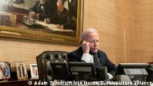 February 18, 2021 - Washington, District of Colombia, USA - President Joe Biden talks on the phone with Texas Gov. Greg Abbott Thursday, Feb. 18, 2021, in the Treaty Room in the Residence of the White House. (Credit Image: © Adam Schultz/White House/ZUMA Wire/ZUMAPRESS.com