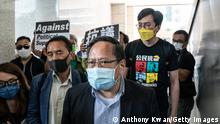HONG KONG, CHINA - APRIL 01: Pro-democracy activist and former lawmaker Albert Ho leaves the West Kowloon Magistrates Courts following a hearing on April 1, 2021 in Hong Kong, China. Seven prominent democratic figures, including Apple Daily founder Jimmy Lai, former lawmaker and barrister Martin Lee and Margaret Ng, were convicted of unauthorized assembly in relation to a peaceful protest on Aug. 18 in 2019. (Photo by Anthony Kwan/Getty Images)