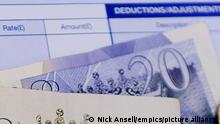 Paid holidays and payslips. EMBARGOED TO 0001 MONDAY SEPTEMBER 16 File photo of money on a wage slip. Around one in 20 workers do not receive any paid holidays, and one in 10 does not get a payslip, according to a think-tank. Issue date: Monday September 16, 2019. The Resolution Foundation said its study highlights the scale of unlawful working practices across the UK. Its research indicates that workers over the age of 65 are most likely to not have paid holidays, despite the legal entitlement to 28 days a year, or pro-rota for part-timers.See PA story INDUSTRY Holidays. Photo credit should read: Nick Ansell/PA Wire URN:45277212