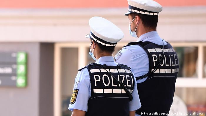 Two masked police officers pictured from behind in Germany