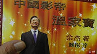 A copy of the new book China's Best Actor: Wen Jiabao authored by Yu Jie is picked up as they are displayed for sale at a bookstore in Hong Kong Monday, Aug. 16, 2010. The book by Chinese dissident author Yu who says he was threatened with imprisonment argues China's premier is not a reformist nor a man of the people, as popularly perceived at home, but a mediocre technocrat who rose to power through good acting. (AP Photo/Kin Cheung)