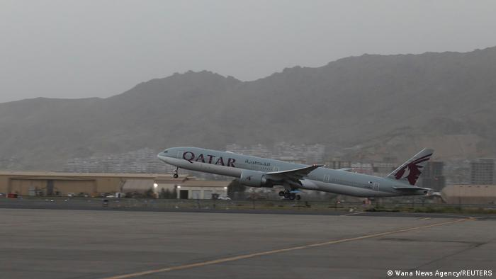A Qatar Airways flight takes off from the international airport in Kabul