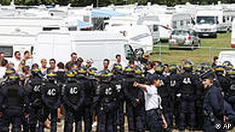 Riot policemen take position outside a camp in Langlet, France