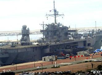 The USS Blue Ridge LCC19 at anchor in a naval port in Busan, South Korea