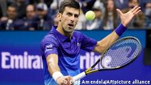 Novak Djokovic, of Serbia, drops a shot against Alexander Zverev, of Germany, during the semifinals of the US Open tennis championships, Friday, Sept. 10, 2021, in New York. (AP Photo/Elise Amendola)