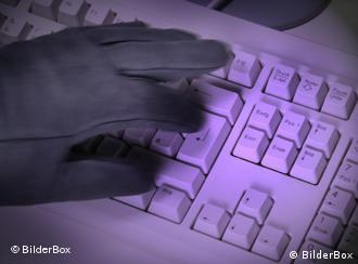 A keyboard and a gloved hand