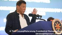 In this photo provided by the Malacanang Presidential Photographers Division, Philippine President Rodrigo Duterte administers the oath taking ceremony during the national convention of his PDP-Laban party in San Fernando, Pampanga province, northern Philippines, Wednesday Sept. 8, 2021. The Philippines' governing party nominated Duterte on Wednesday as its vice presidential candidate in upcoming elections, a maneuver widely seen as an effort to keep the popular leader near the center of power while avoiding constitutional term limits. (Toto Lozano/Malacanang Presidential Photographers Division via AP)