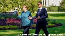 German Chancellor Angela Merkel, left, meets Poland's Prime Minister Mateusz Morawiecki in Warsaw, Poland, Saturday, Sept.11, 2021.Merkel is visiting the Polish capital Morawiecki at a time when Poland faces migration pressure on its eastern border with Belarus. (AP Photo/Czarek Sokolowski)