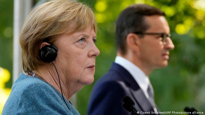 Angela Merkel pictured in Warsaw next to Poland's Prime Minister Mateusz Morawiecki