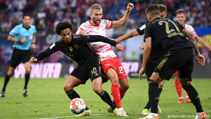 Bayern Munich's Leroy Sane wins the ball from Leipzig midfielder Konrad Laimer