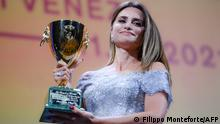 Spanish actress Penelope Cruz acknowledges receiving the Coppa Volpi for Best Actress in Madres Paralelas (Parallel Mothers) during the closing ceremony of the 78th Venice Film Festival on September 11, 2021 at Venice Lido. (Photo by Filippo MONTEFORTE / AFP)