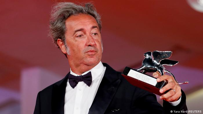 Italian filmmaker Paolo Sorrentino holds up the Silver Lion