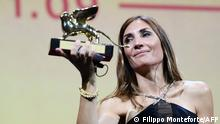 French director Audrey Diwan acknowledges receiving the Golden Lion for Best Film for L'Evenement (Happening) during the closing ceremony of the 78th Venice Film Festival on September 11, 2021 at Venice Lido. (Photo by Filippo MONTEFORTE / AFP)
