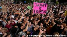 More than 10,000 people joined a protest of organizers and fans of music festivals stage against the government's COVID-19 restrictions on large-scale outdoor events in Amsterdam, Netherlands, Saturday, Sept. 11, 2021. On Saturday, the festivals came to music fans as hundreds of performers and festival organizers called again for demonstration marches through Dutch cities to protest what they argue are unfair restrictions that have forced the cancellation of summer festivals and other events. (AP Photo/Peter Dejong)