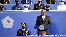 Secretary of Defense Lloyd Austin, accompanied by Joint Chiefs Chairman Gen. Mark Milley, seated left, speaks during an observance ceremony at the Pentagon in Washington, Saturday, Sept. 11, 2021, on the morning of the 20th anniversary of the terrorist attacks. (AP Photo/Alex Brandon)