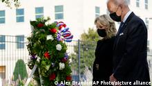 11.09.2021 President Joe Biden and first lady Jill Biden participate in a wreath ceremony on the 20th anniversary of the terrorist attacks at the Pentagon in Washington, Saturday, Sept. 11, 2021, standing at the National 9/11 Pentagon Memorial site, which commemorates the lives lost at the Pentagon and onboard American Airlines Flight 77. With the President, not shown, are Vice President Kamala Harris and her husband Douglas Emhoff, Secretary of Defense Lloyd Austin and Joint Chiefs Chairman Gen. Mark Milley and his wife Hollyanne Milley. (AP Photo/Alex Brandon)