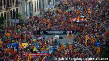 11.09.2021 BARCELONA, SPAIN - SEPTEMBER 11: People wave Catalan pro-independence Estelada flags during a demonstration marking the Diada, national day of Catalonia, in Barcelona, Spain on September 11, 2021. Adria Puig / Anadolu Agency