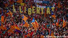 11.09.2021 People hold up Estelada flags (Catalan separatist flag) during Catalonia's national day, 'La Diada', in Barcelona, Spain, September 11, 2021. The banner reads freedom. REUTERS/ Albert Gea