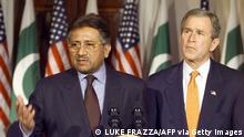 WASHINGTON, : US President George W. Bush (R) and Pakastani President General Pervez Musharraf speak to reporters 13 February 2002 at the White House after their meeting there. Pervez has worked closely with the US Government in its war in Afghanistan. AFP PHOTO/Luke FRAZZA (Photo credit should read LUKE FRAZZA/AFP via Getty Images)