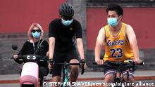 Chinese wear face masks outside after being told to wear face masks outdoors again in Beijing, on Thursday, August 5, 2021. China has once again put much of the country on high alert with travel restrictions, lockdowns and mandatory Covid tests due to new cases of the coronavirus. Photo by Stephen Shaver/UPI Photo via Newscom picture alliance