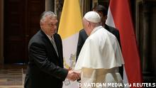 Pope Francis shakes hands with Hungary's Prime Minister Viktor Orban at Romanesque Hall in the Museum of Fine Arts in Budapest, Hungary, September 12, 2021. Vatican Media/Handout via REUTERS ATTENTION EDITORS - THIS IMAGE WAS PROVIDED BY A THIRD PARTY.