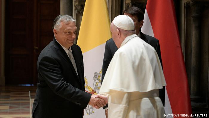 Pope Francis shakes hands with Hungary's Prime Minister Viktor Orban at Romanesque Hall in the Museum of Fine Arts in Budapest
