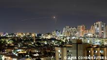 Streaks of light are seen as Israel's Iron Dome anti-missile system intercepts a rocket launched from the Gaza Strip towards Israel, as seen from Ashkelon, Israel September 11, 2021. REUTERS/Amir Cohen