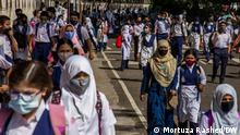 They were sent by our correspondent Mortuza Rashed from Bangladesh. Photo: Schools in Bangladesh have been opened after one and a half year of corona pandemic. via Rahat Rafe
