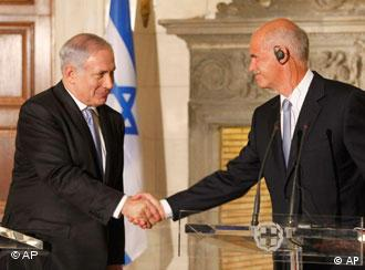 Israeli Prime Minister Benjamin Netanyahu, left, shakes hand with his Greek counterpart George Papandreou after a joint news conference in Athens