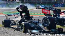 Mercedes' British driver Lewis Hamilton gets out of his car following a collision with Red Bull's Dutch driver Max Verstappen (unseen) during the Italian Formula One Grand Prix at the Autodromo Nazionale circuit in Monza, on September 12, 2021. (Photo by ANDREJ ISAKOVIC / AFP) (Photo by ANDREJ ISAKOVIC/AFP via Getty Images)