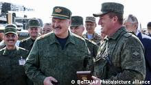 Belarusian President Alexander Lukashenko, center, and high level Russian and Belarusian officers attend the joint strategic exercises of the armed forces of the Russian Federation and the Republic of Belarus Zapad-2021 at the Obuz-Lesnovsky training ground, Belarus, Sunday, Sept. 12, 2021. The military drills attend by servicemen of military units and divisions of the Western Military District, representatives of the leadership headquarters and personnel of military contingents of the armed forces of Armenia, Belarus, India, Kazakhstan, Kyrgyzstan and Mongolia. (BelTA Pool Photo via AP)