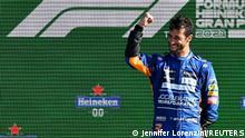 Formula One F1 - Italian Grand Prix - Autodromo Nazionale Monza, Monza, Italy - September 12, 2021 McLaren's Daniel Ricciardo celebrates on the podium with after winning the race REUTERS/Jennifer Lorenzini