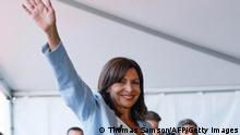 TOPSHOT - The mayor of Paris, member of the French Socialist Party (Parti Socialiste - PS) Anne Hidalgo waves in Rouen, western France, on September 12, 2021 after announcing that she plans to stand as a PS candidate in next year's presidential elections. (Photo by Thomas SAMSON / AFP) (Photo by THOMAS SAMSON/AFP via Getty Images)