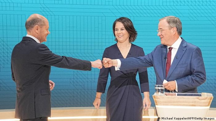 The three top German chancellor candidates greet each other