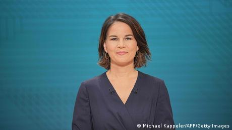 Annalena Baerbock smiling into the camera before the TV debate on September 12